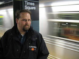 Mark with subway train in background.