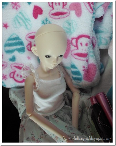 bjd sitting in a thrift store haul