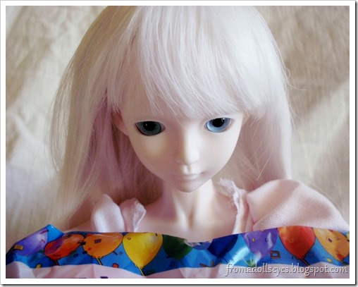 Ball Jointed Doll Staring at Latex Balloons in Disbelief