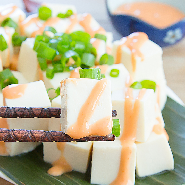close-up photo of a piece of tofu salad with bang bang sauce