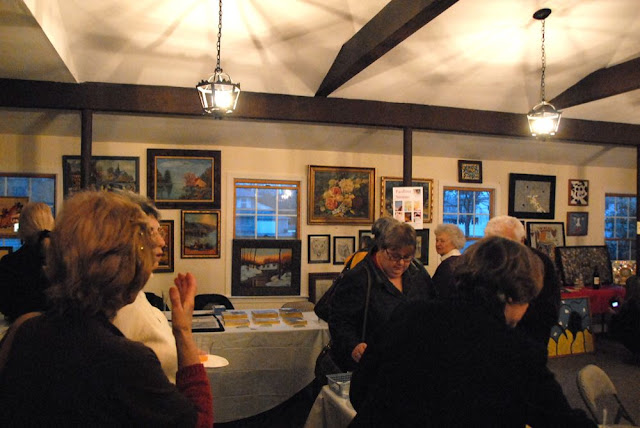 Guests enjoy viewing and discussing the art.