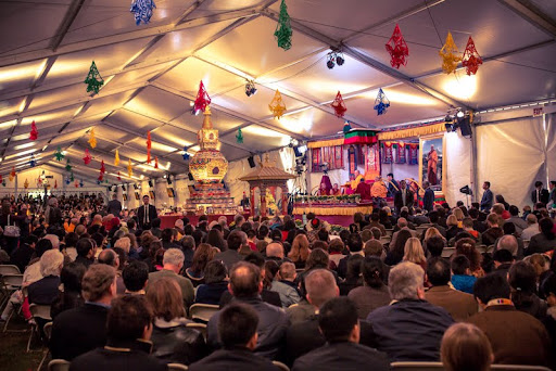 His Holiness the Dalai Lama speaking in the big tent behind Kurukulla Center, Medford, Massachusetts, U.S., October 2012. Photo by Kadri Kurgun.