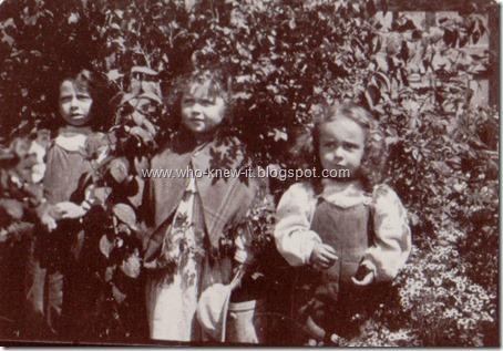 3 kids in garden