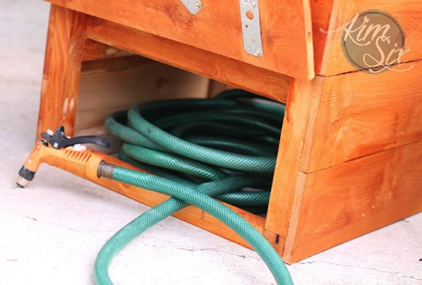 Hidden hose storage