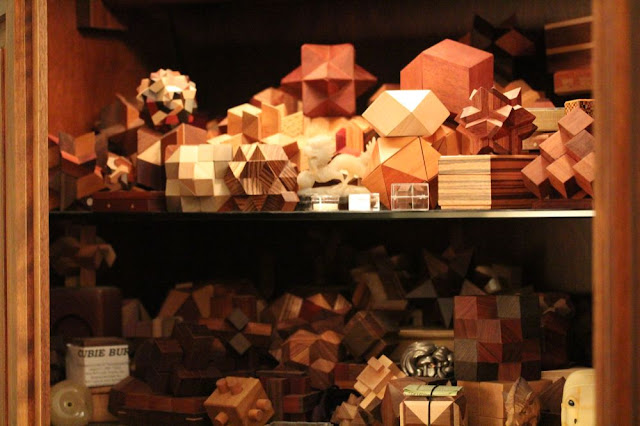 a cupboard full of pretty wooden puzzles