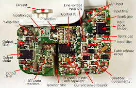 The circuit board inside a genuine iPad charger showing the components.