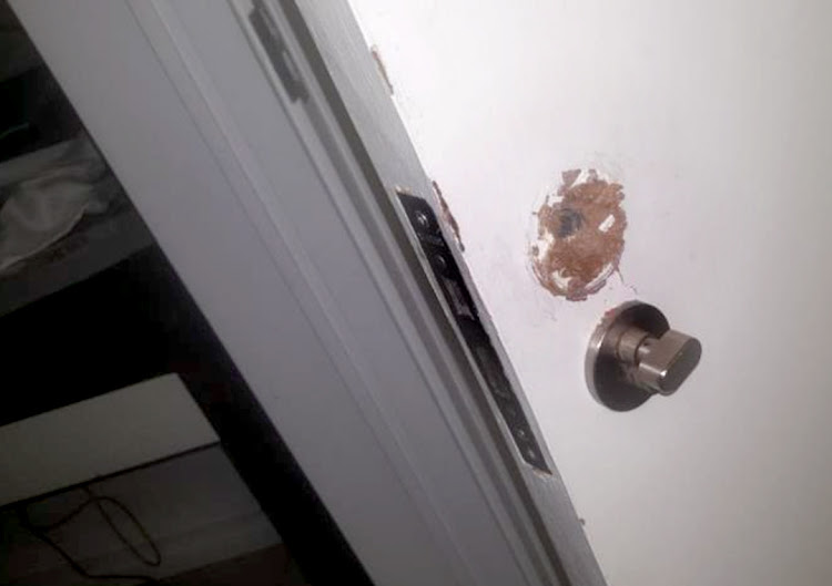 The damaged door in the room at the Capital 20 West in Sandton on 13 August 2017.