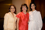 Fara Talebi; Nancy Best, president of the Board of Trustees for Genesis Women's Shelter; and Raha Talebi