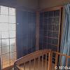 1階の階段下の小窓からの光漏れ防止のためガラス戸に遮光フィルムを貼った
