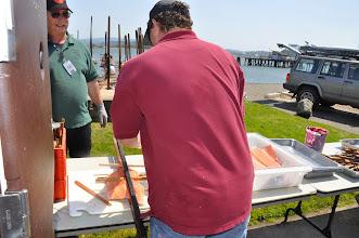 Photo: loading salmon on the sticks