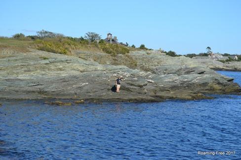 Tom climbing on the rocks