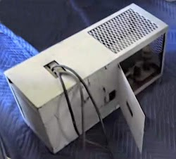 REC 30 Teletype power supply in its case painted Navy gray. The power cords exit the top. The tubes are behind the door on the right.