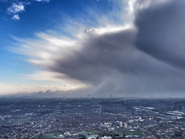 Aerial view of a huge cloud formation moving over the center of London, partly obscuring its skyline, on 27 February 2018. The cold air, which originated over Siberia but moved west due to unusually warm weather over the North Pole, earned the nickname 'The Beast from the East' in Britain. Familiar buildings like The Shard, western Europe's tallest skyscraper, and other landmarks in London's main business area can be identified in the image. Photo: National Police Air Service