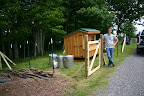 David installing electric fence around the chicken coop.