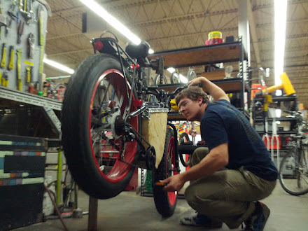 A mechanic working on his bike.