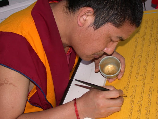Ven.Tsering writing the Prajnaparamita in gold at Kachoe Dechen Ling, USA