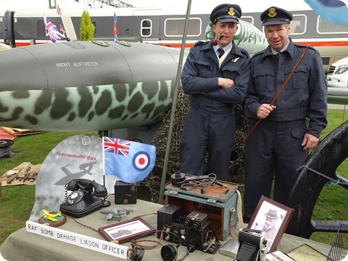 Second World War RAF officers  alongside a replica V-1 flying bomb