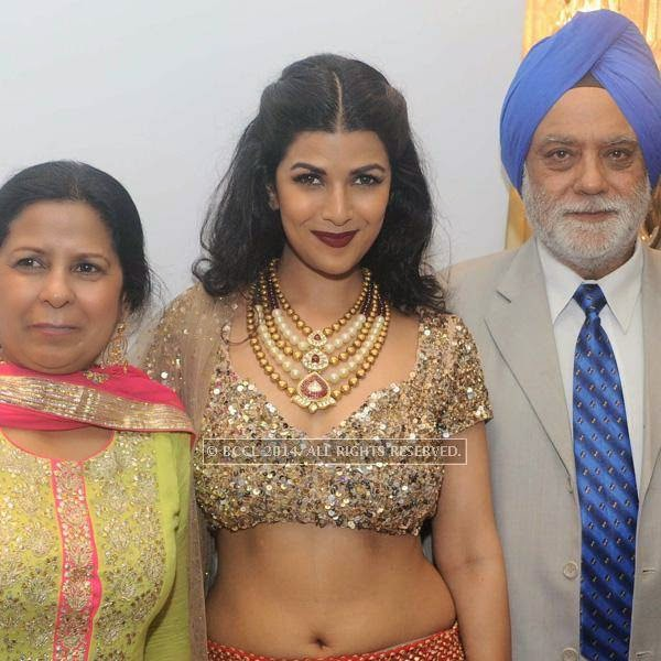 Nimrit Kaur with parents Avinash(mom) and Colonel Sethi at fashion designer Rina Dhaka's pre show cocktail party, held in New Delhi.