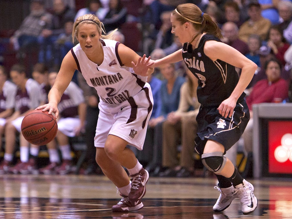 Torry Hill sweeps her way past the Vandal's unforgiving press, led by sophomore point guard Krissy Karr (#3).  Dahlberg Arena in Missoula, Mont., November 29th, 2012.