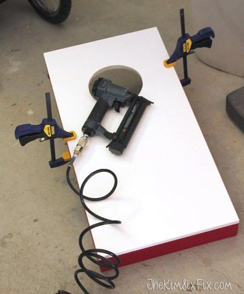 Nailing cornhole board onto base