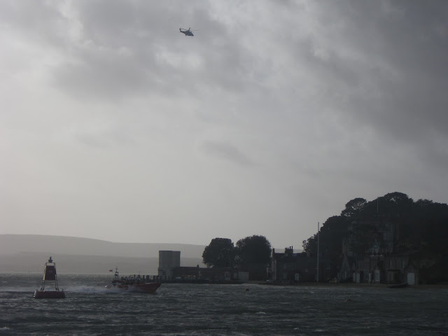 The ILB returns to harbour close to Brownsea Island, and the coastguard helicopter returns to Portland. 7 January 2014.  Photo credit: Anne Millman, RNLI Poole.