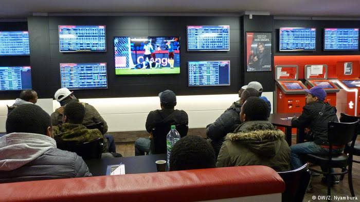 Sports investors at a gaming shop
