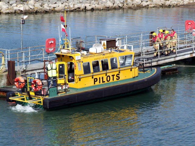 20 April 2012 - Firefighters board the pilot boat Vanguard in Poole port to be taken across to Green Island (Photo credit: Kevin Mitchell, Maritime Images)