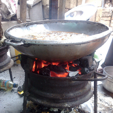 A cooking stove in Ghana, made from an old car wheel rim.
