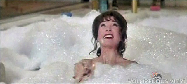 Shirley Maclaine taking a bubble bath.