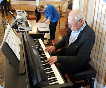 John Holster playing the Village's Yamaha Clavinova CVP-709