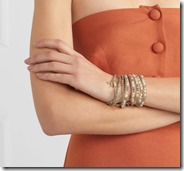 Chan Luu gold tone wrap bracelet on model