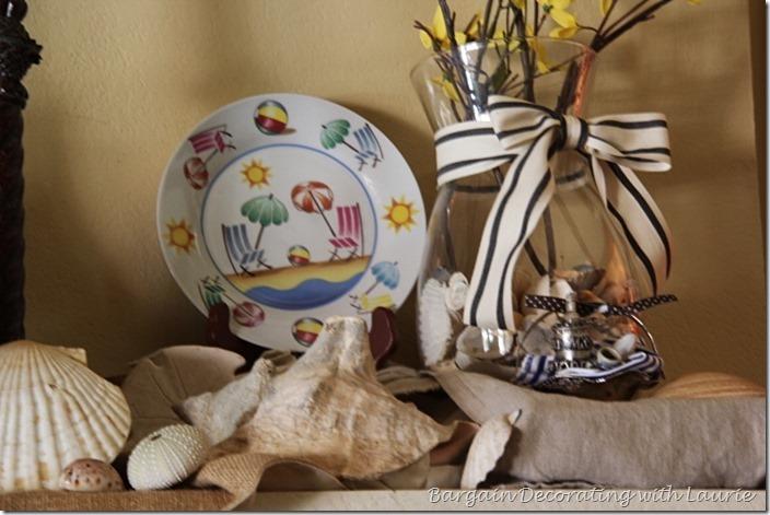 Mantel decor with beach chars and seashells