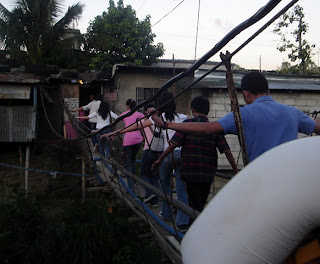 February 22: Students cross a makeshift bridge used as shortcut from Kurt's house.