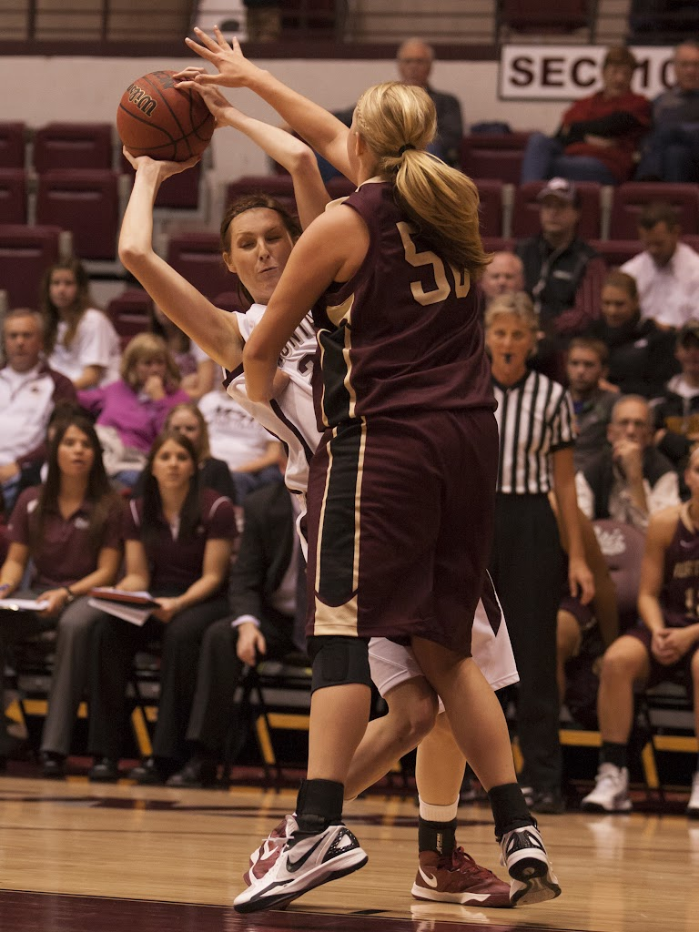 Lady Griz forward Carly Selvig fights for one of her two defensive rebounds Tuesday evening in the face of MSU-Northern's Laci Keller.  Selvig dominated the paint, leading the Lady Griz with five of the team's ten blocks.  Dahlberg Arena in Missoula, Mont., November 13th, 2012.