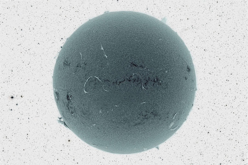 Black Sun and Inverted Starfield. Image Credit & Copyright: Jim Lafferty