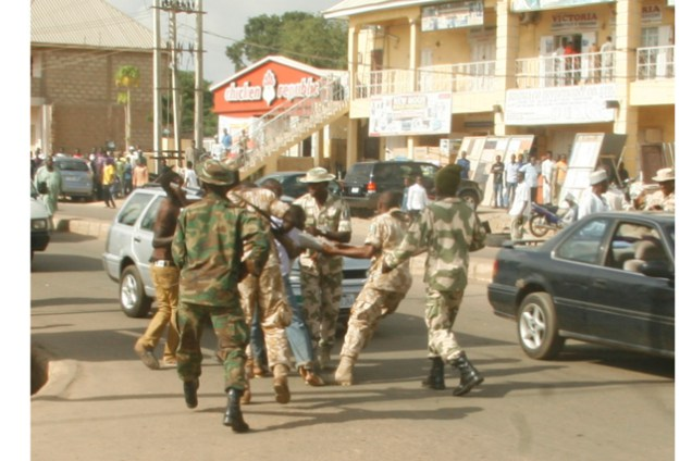 Soldiers Chain Man To Motorcycle In Lagos, Drags Him On Street (Photos)