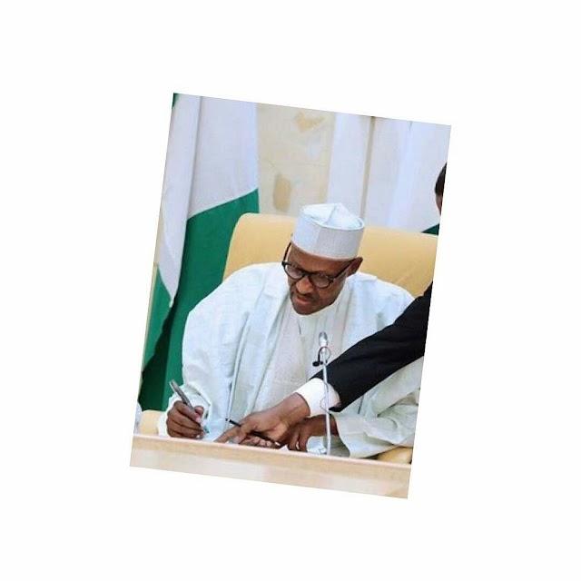 #Buhari Finally Signs N30,000 Minimum Wage Bill Into Law