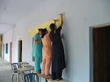 PVs working on murals in the degree college