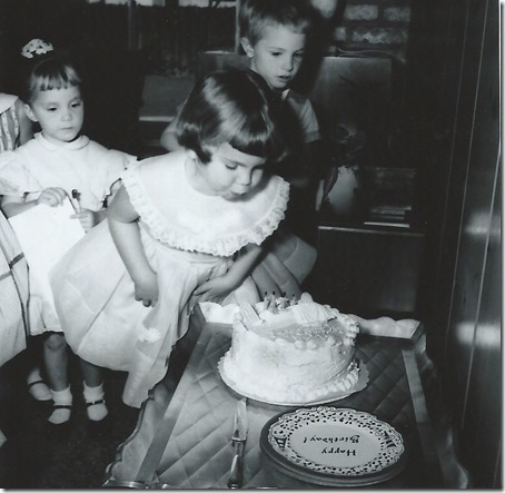 Page 18 - Debi blowing out candles