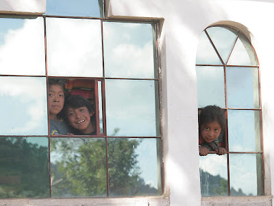 Children in the next village. Jason and I had gone on a walk and were lost in the maze of the village trying to find our way out to the road, feeling somewhere between intrusive and nervous,when all these kids appeared in a window. Photos by TOM HART