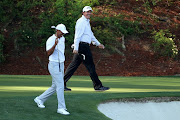 FILE PHOTO: Phil Mickelson of the U.S. shares a laugh with compatriot Tiger Woods (L) on the 12th green during the second day of practice for the 2018 Masters golf tournament at Augusta National Golf Club in Augusta, Georgia, U.S. April 3, 2018.
