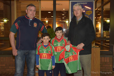 Pictured: Mark Redmond, James McHugh, Killian Redmond and Sean Corcoran, the mng of McDonald's presents jerseys for Garrycastle GAA club. Photos:  Vilma Lizaityte