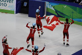Team Canada celebrating gold in the men's 5000m relay
