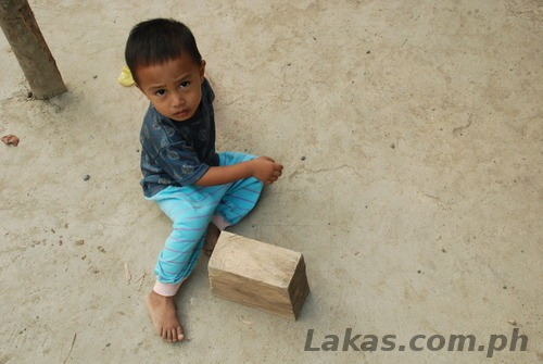 Child I talked to playing with a wooden brick