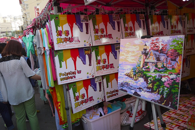 painting by numbers kits for sale at a street market