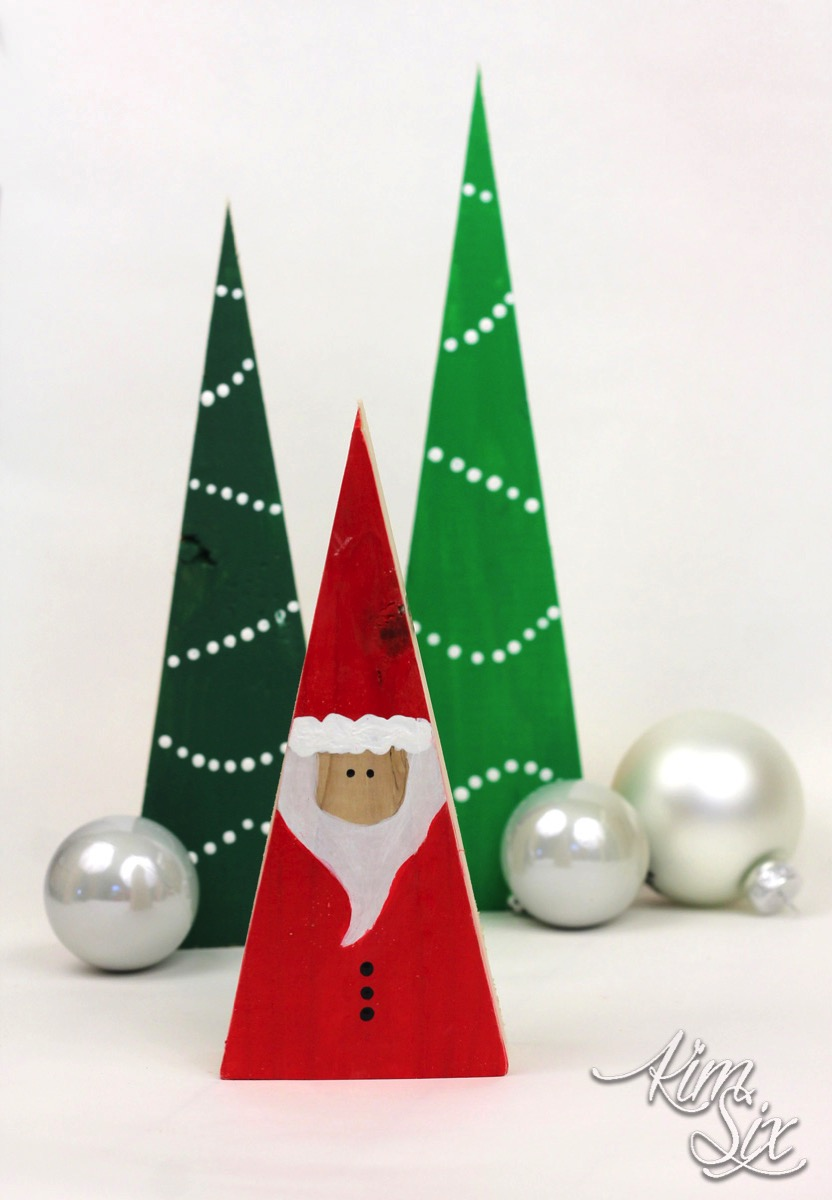 Wooden triangle santa and christmas trees