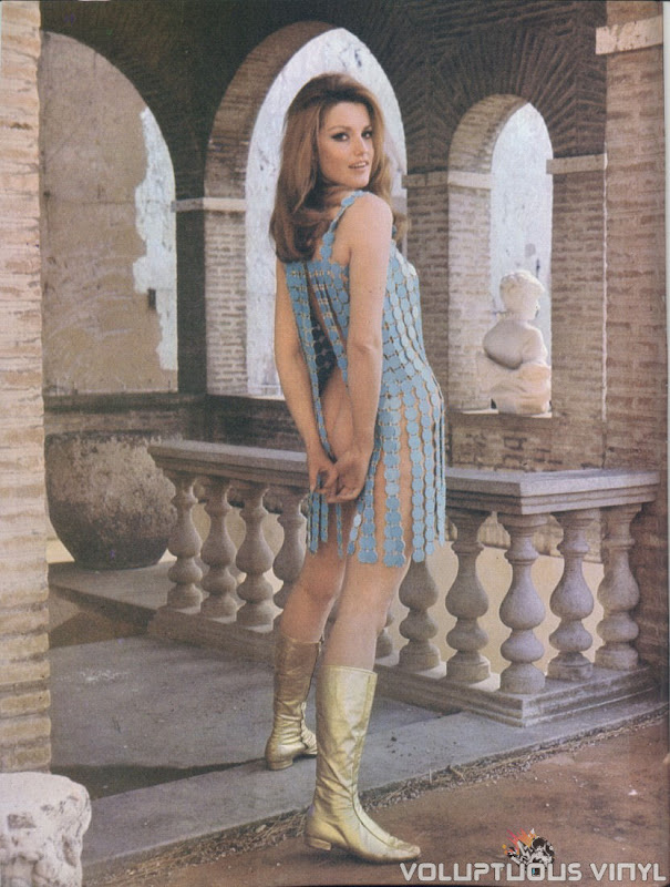 Magda Konopka 70's blue sequin dress, gold boots