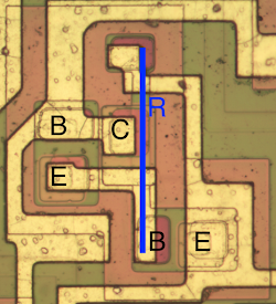 A complex part of the TL084, where two transistors share a collector while a resistor runs through them.