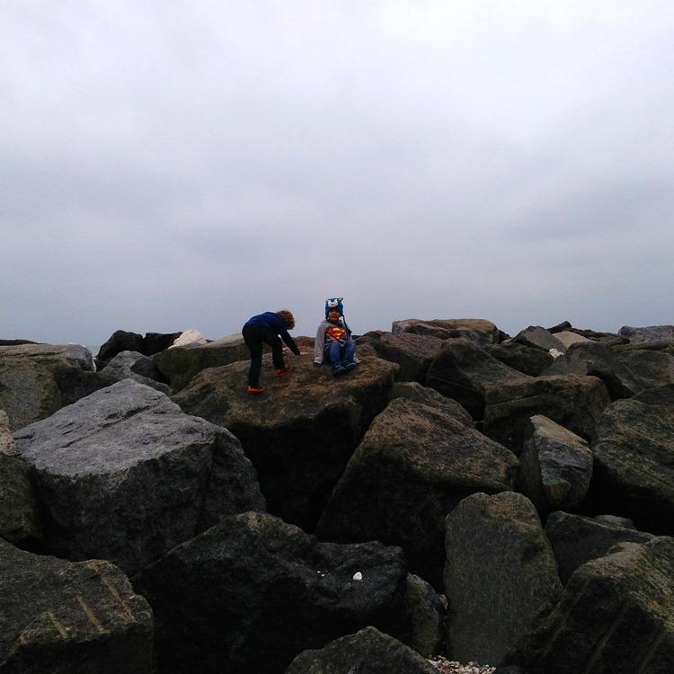 autumnal beach rock climbing