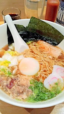 Momofuku Noodle bar, classic Momofuku ramen, with pork belly, pork shoulder, poached egg